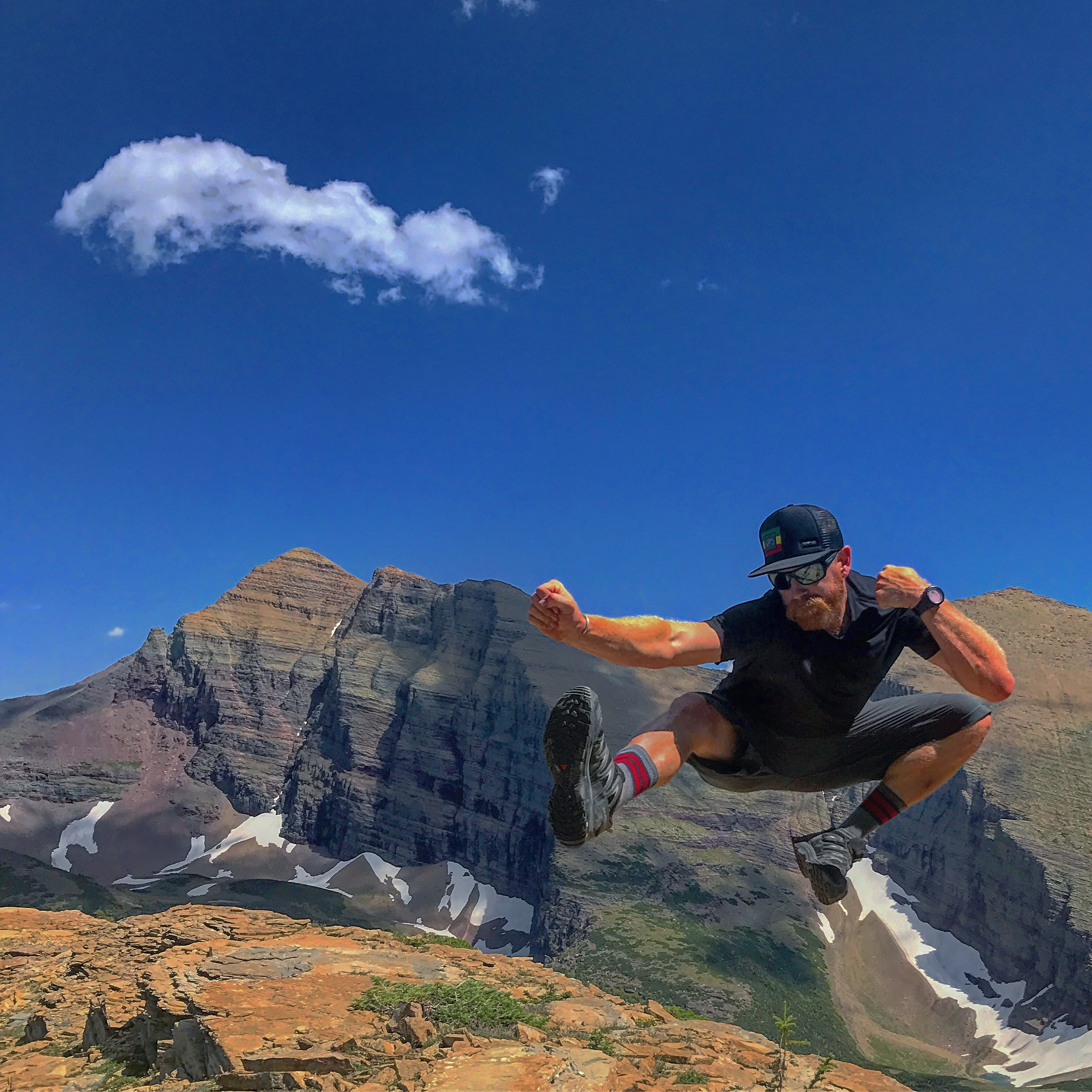 Donovan jumping for joy in Glacier National Park